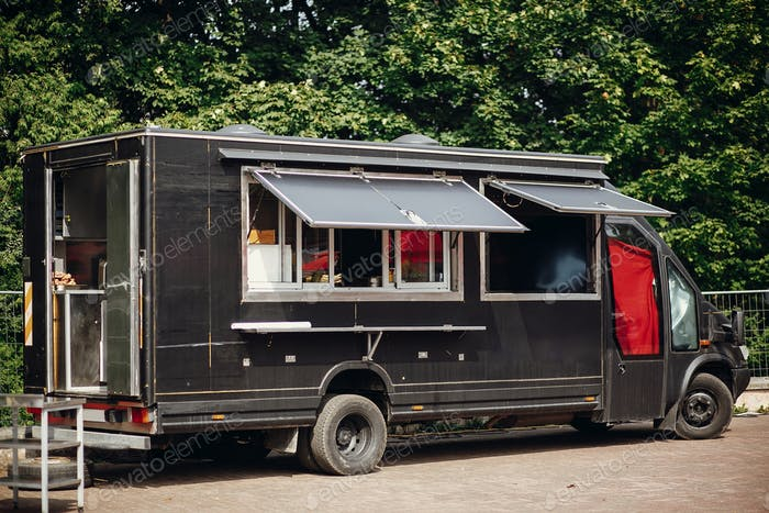Stylish black mobile food truck with burgers and asian food