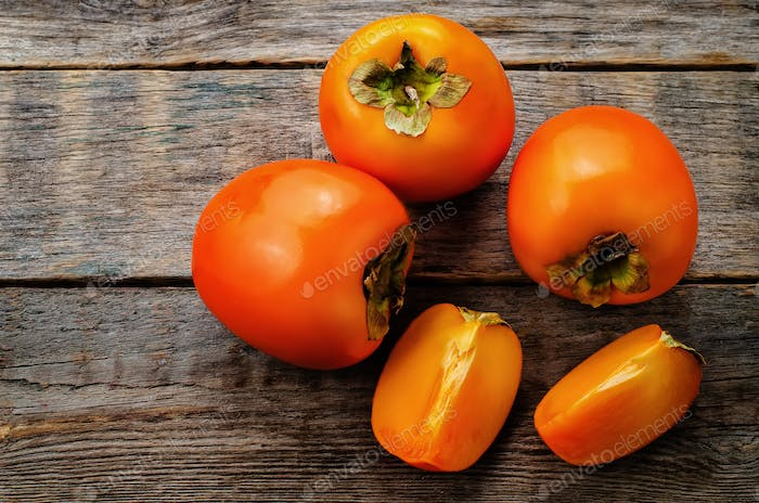 Persimmon on a dark wood background