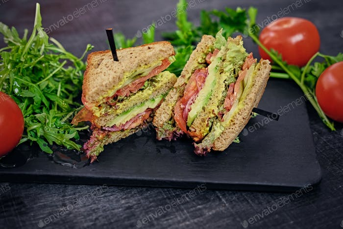 Vegetarian sandwich with salad and tomatoes.