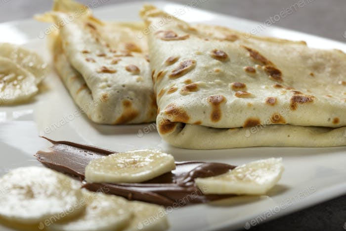 crepes with banana and chocolate sauce