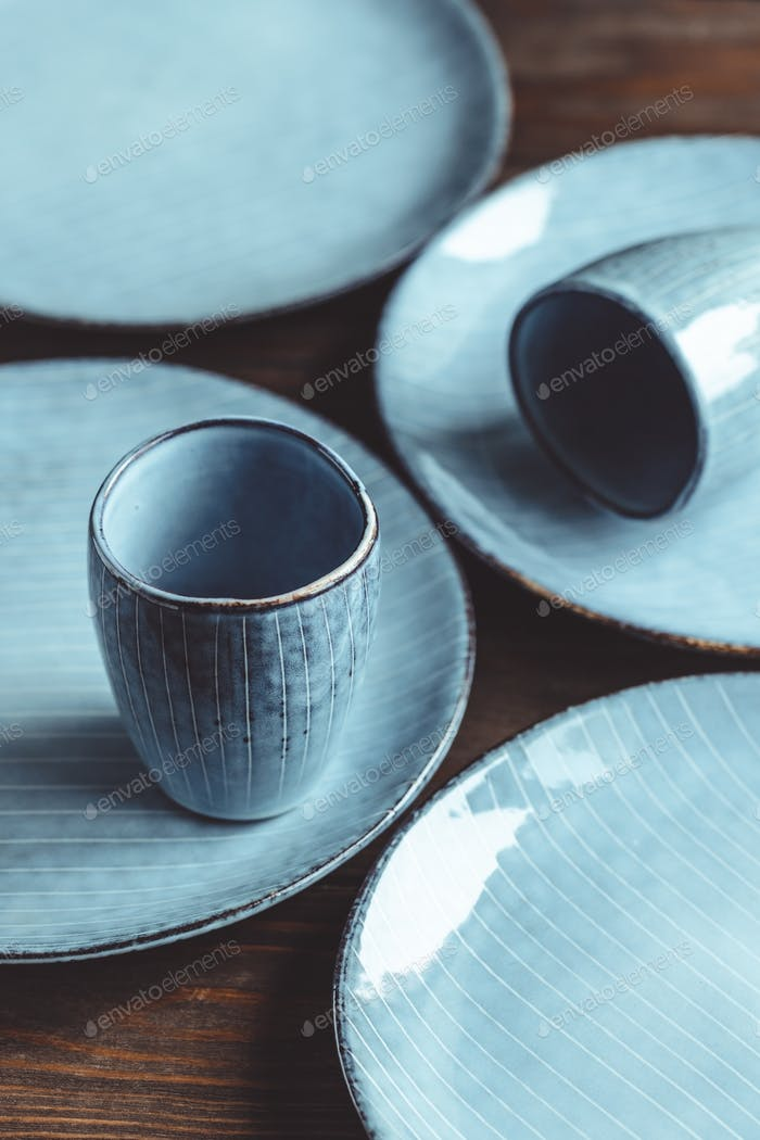 Handmade blue set of ceramic tableware. Espresso cups and plates.