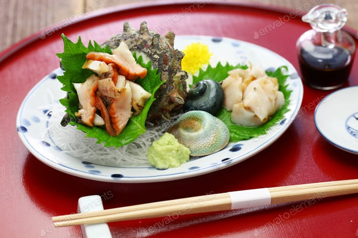 sazae ( horned turban shell ) sashimi, traditional japanese seafood dish