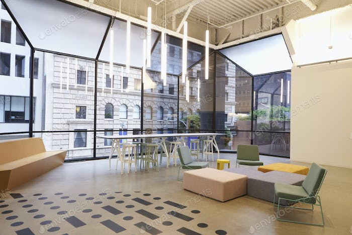Modern windows and furniture in corporate business cafeteria