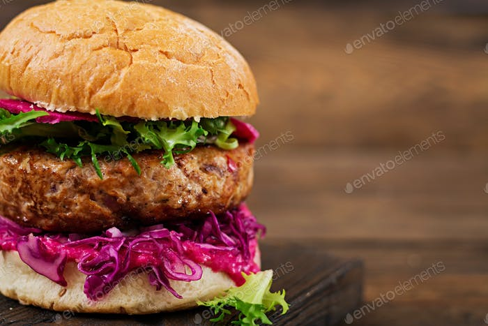 Sandwich hamburger with juicy burgers,  red cabbage and pink sauce