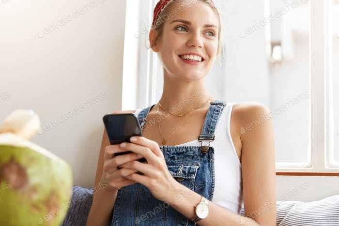 Positive female has vacations, chats in social networks with friends, happy to recieve message from