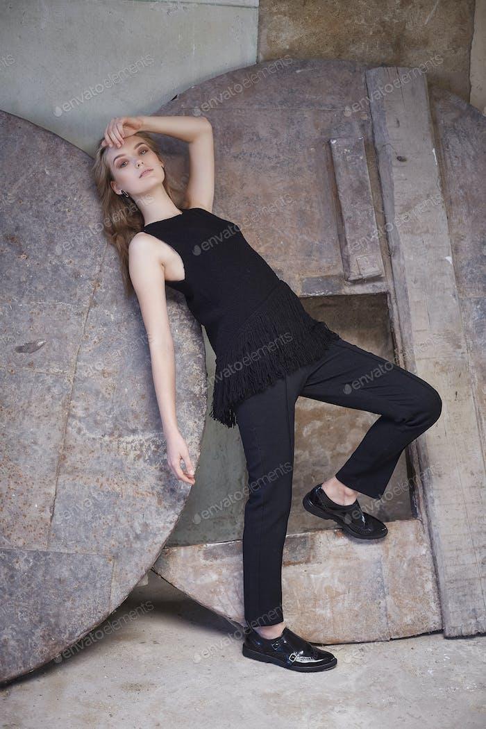 Female in a black costume.