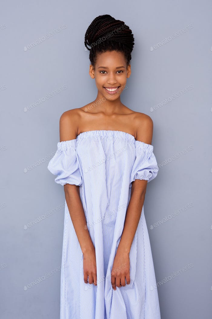 beautiful young black woman in dress abasing gray background
