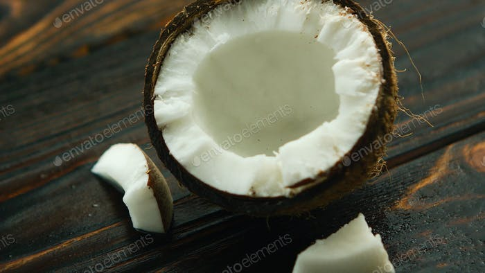 Cracked coconut on table