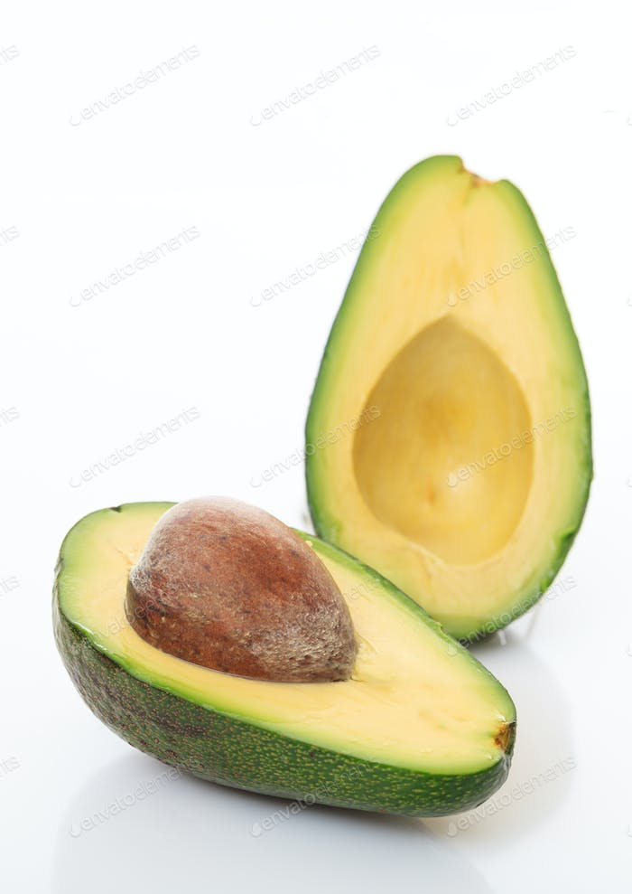 Healthy lifestyle concept. Avocado cut half isolated on white background.