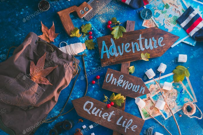 Road sign with Adventure, Unknown and Quiet Life directions. Travel essentials creative header