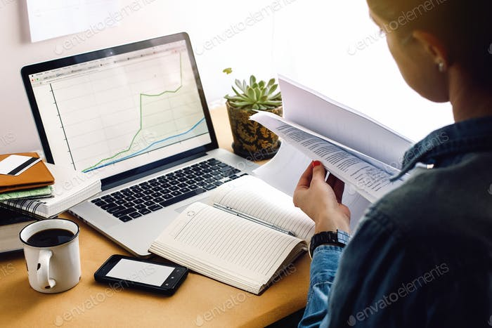 stylish young hipster girl working economist financial analytics