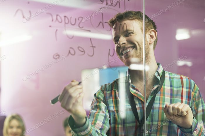 Teacher explaining the lesson to his students.