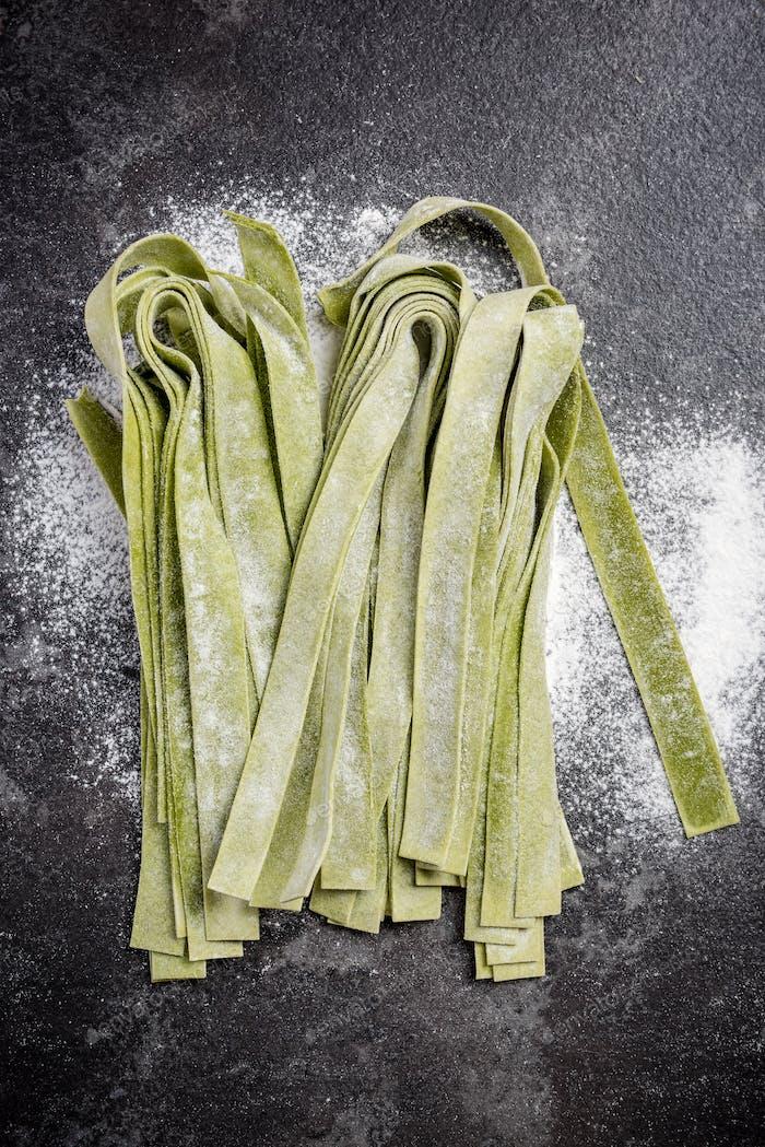 Green spinach homemade raw tagliatelle pasta