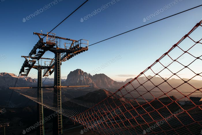 Ladder and net. Cableway standing on the hills in Seceda dolomites