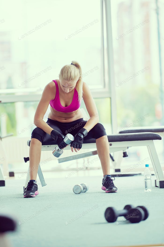young woman exercise with dumbells