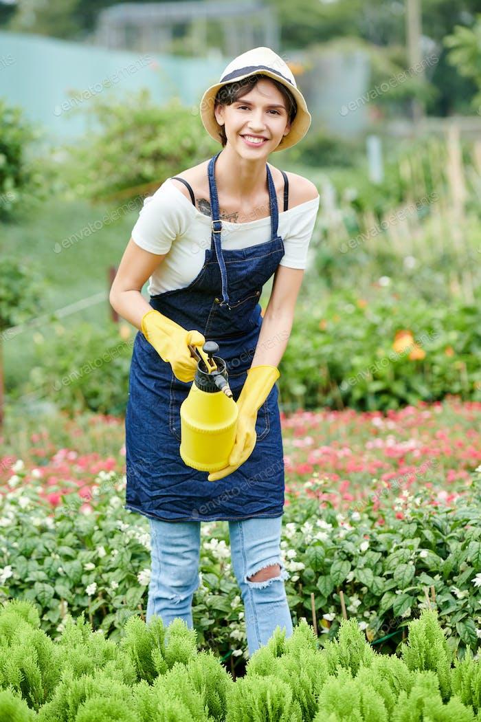 Gardening specialist spraying plants