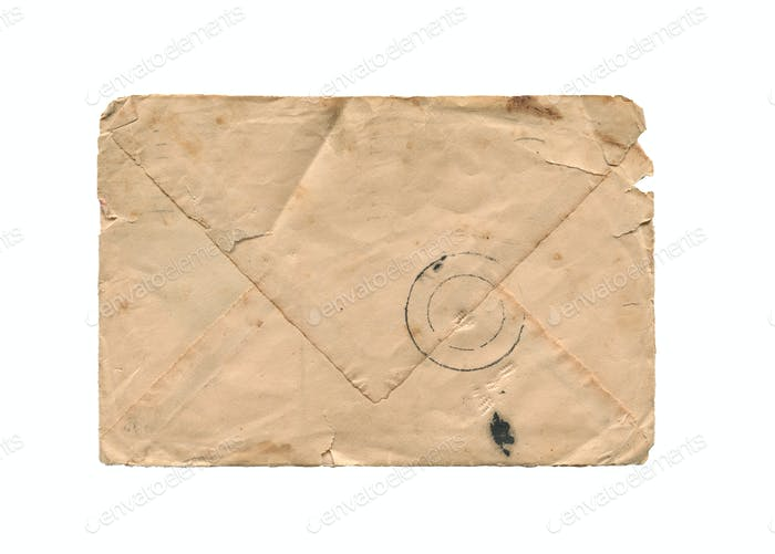 front view of old closed aged paper envelope isolated on white