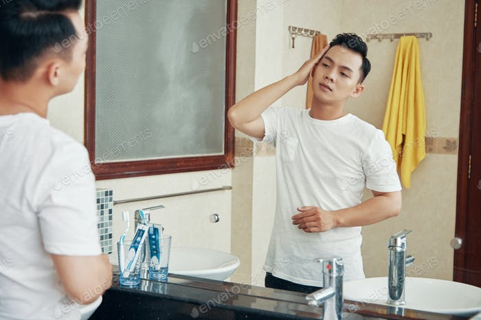 Relaxed man in bathroom in morning time