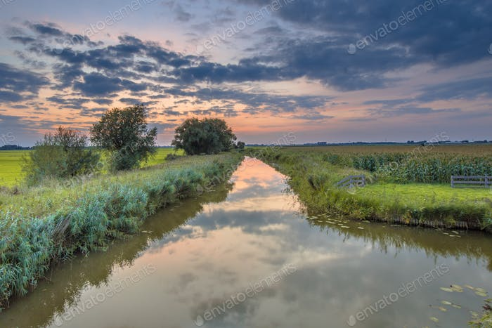 Canal overview in agricultural landscape