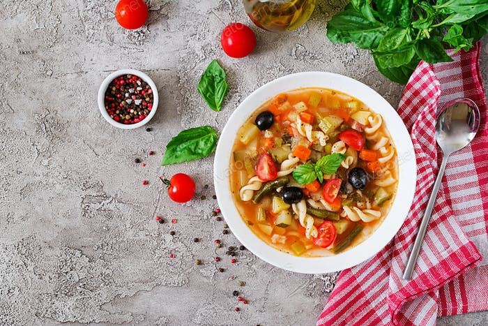Minestrone, italian vegetable soup with pasta. Vegan food. Top view. Flat lay.