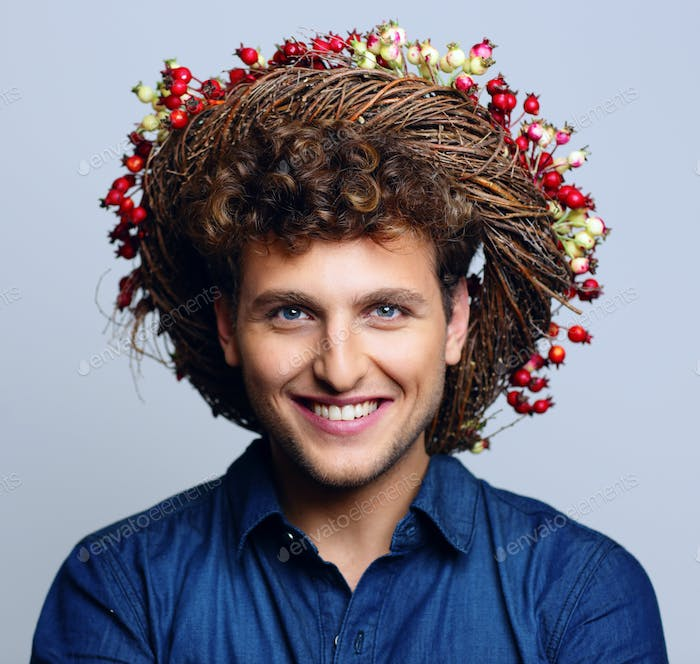 Portrait of a laughing happy man with wreath