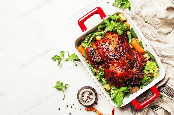 Baked chicken in honey glaze with garnish