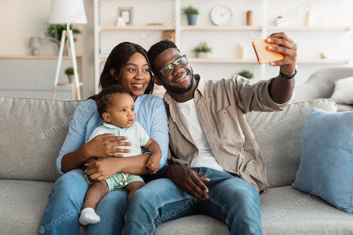 African american family taking selfie together at home