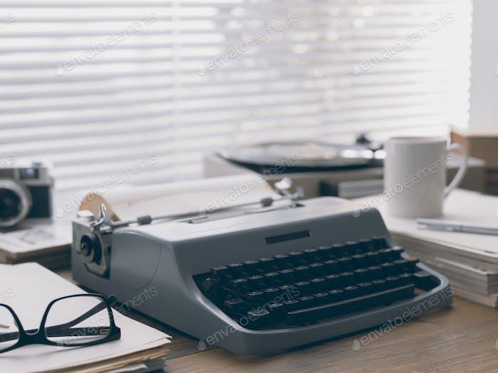 Writer and journalist vintage desktop with typewriter