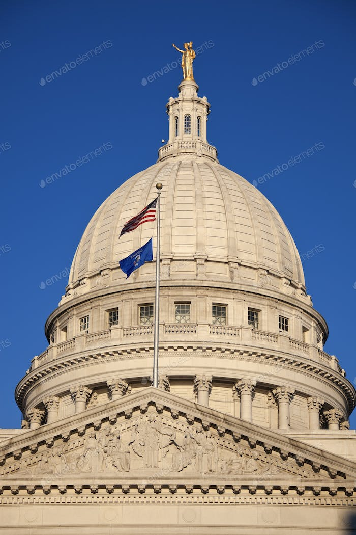 State Capitol Building with US and Wisconsin flags