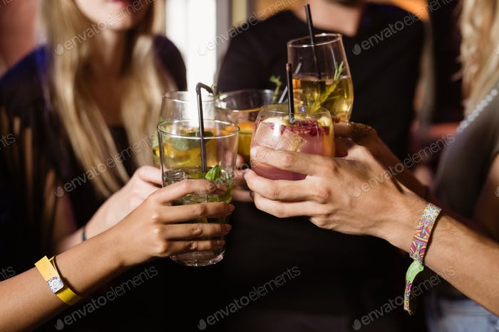 Close up of friends toasting drinks