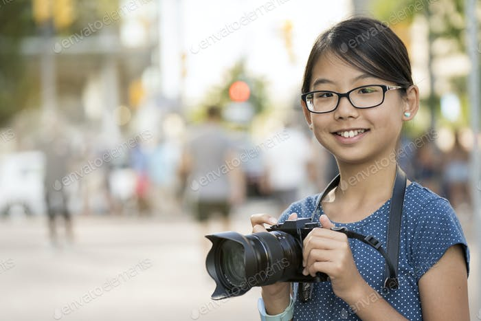 Girl photographer with digital camera