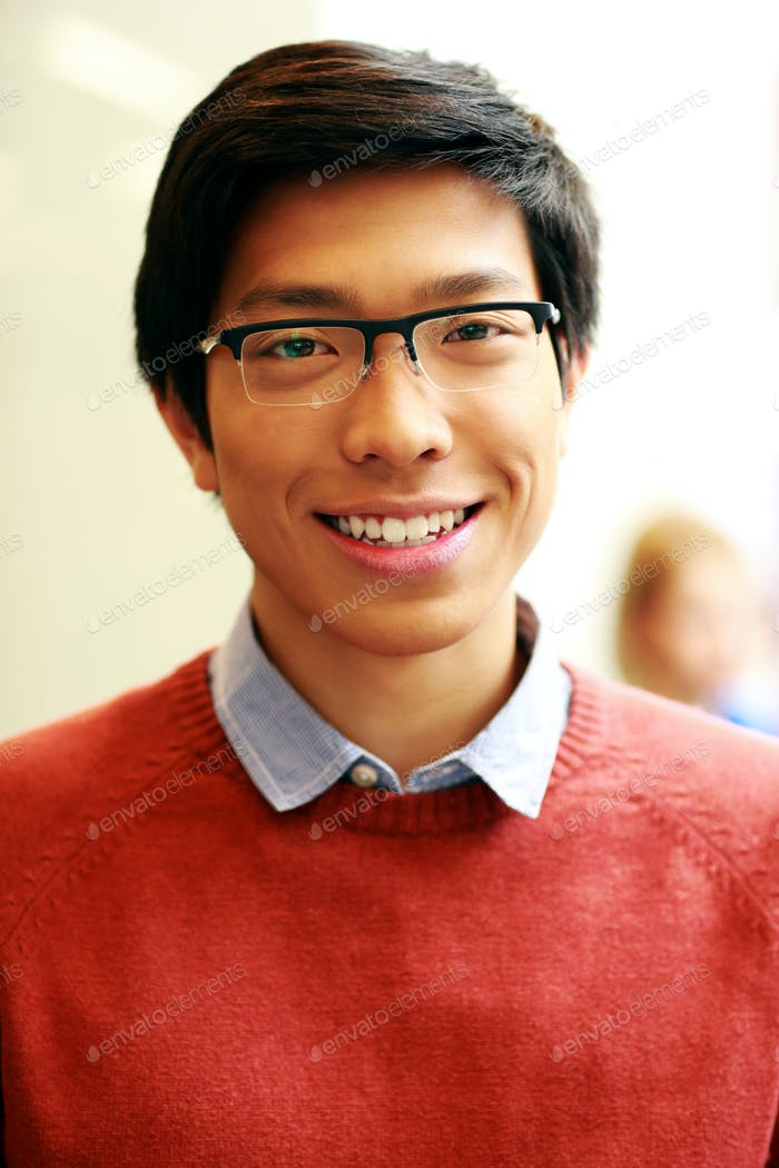 Portrait of a young happy asian man with glasses