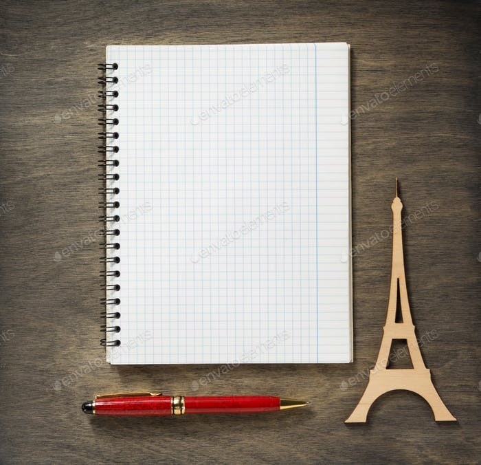 checked notebook and pen