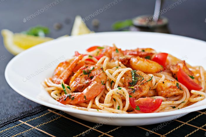 Pasta spaghetti with shrimps, tomato and parsley. Healthy meal. Italian food.