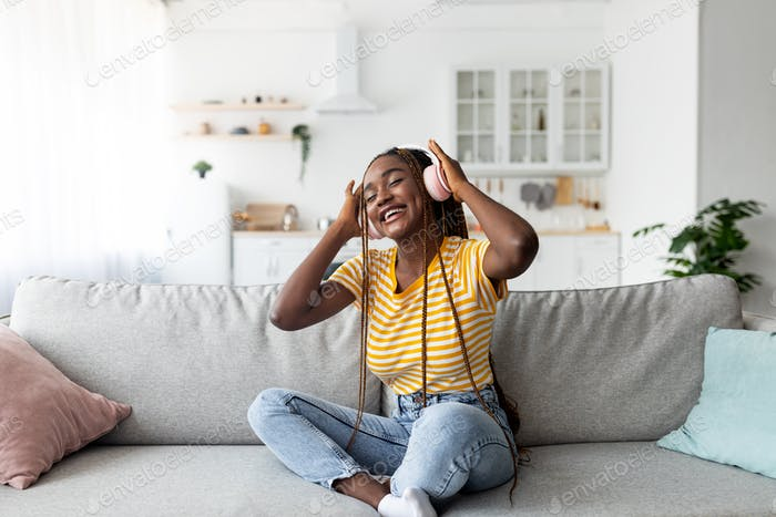 Pretty african american woman listening to music