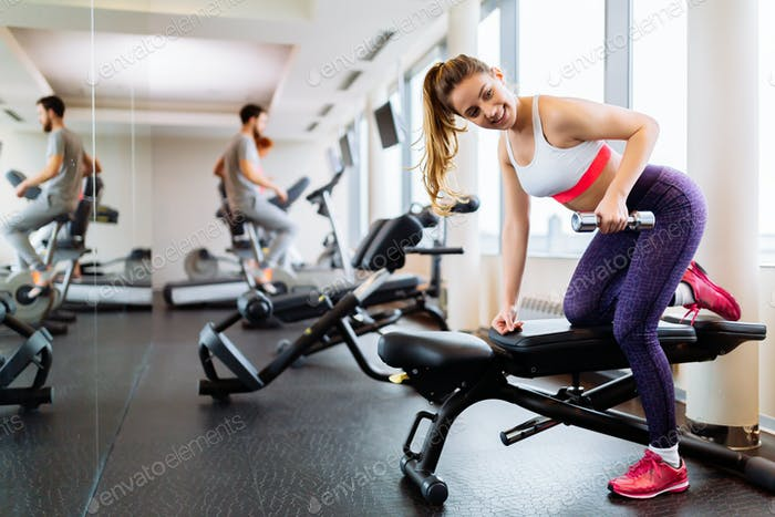 Fit woman working out in gym