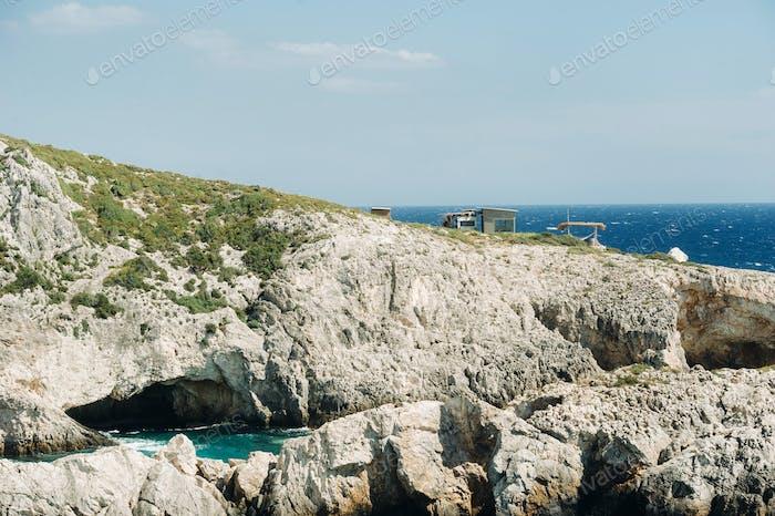 The rocky Porto Limnionas beach on Zakynthos island, Greece