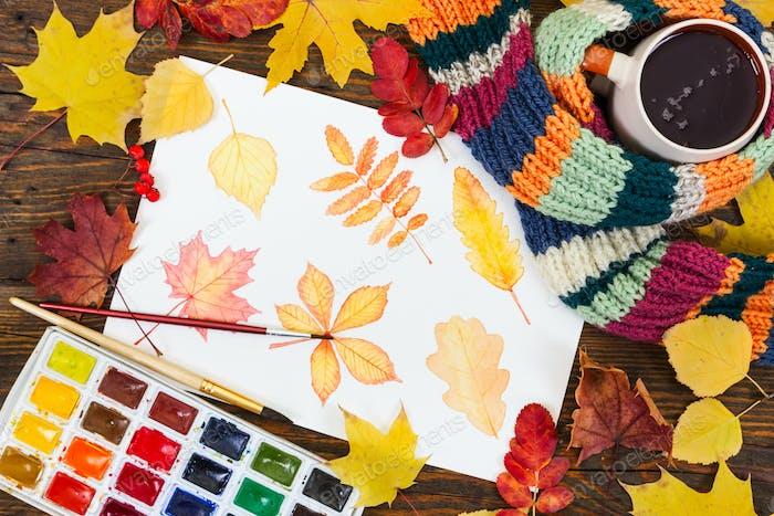 Aquarellmalerei mit Herbstlaub, Farbe, Pinsel und Farbe