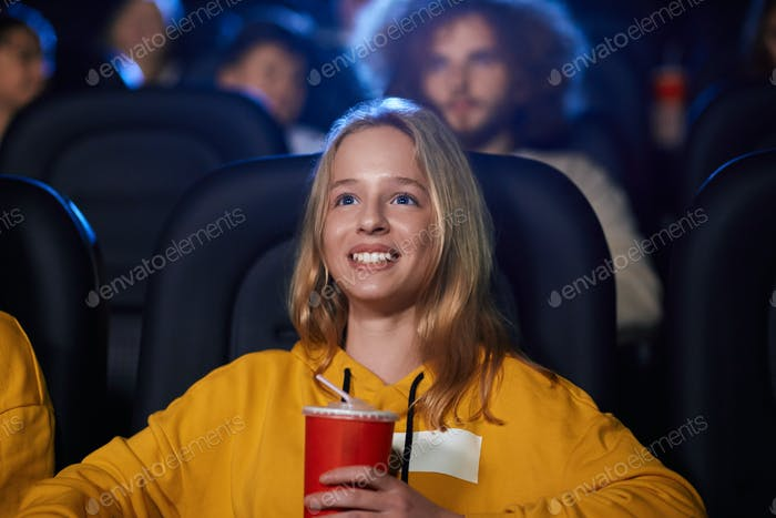 Young teenage girl in movie theater