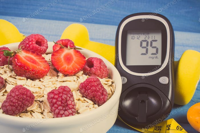 Glucometer for checking sugar level, oatmeal with fruits and dumbbells