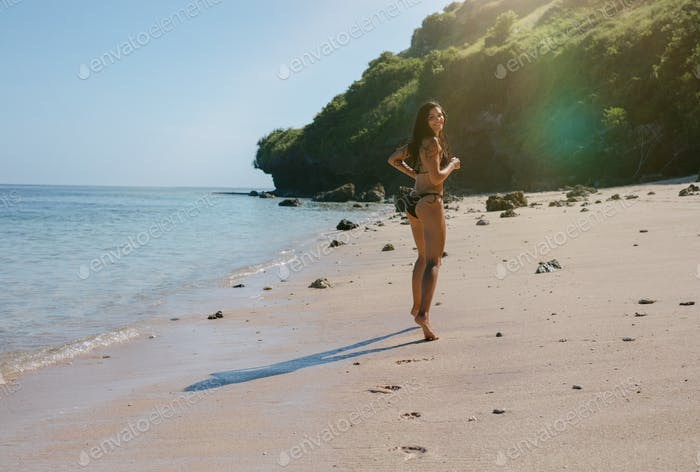 Beautiful woman enjoying holidays on the tropical beach