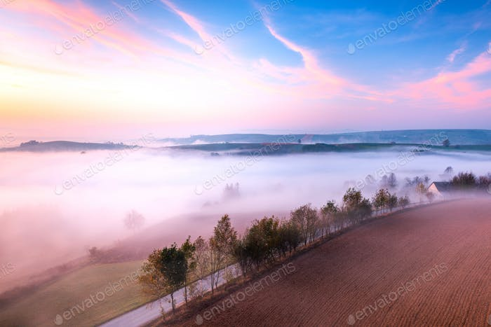 Colorful Sunrise over Polish Rural Countryside . Rolling Fields