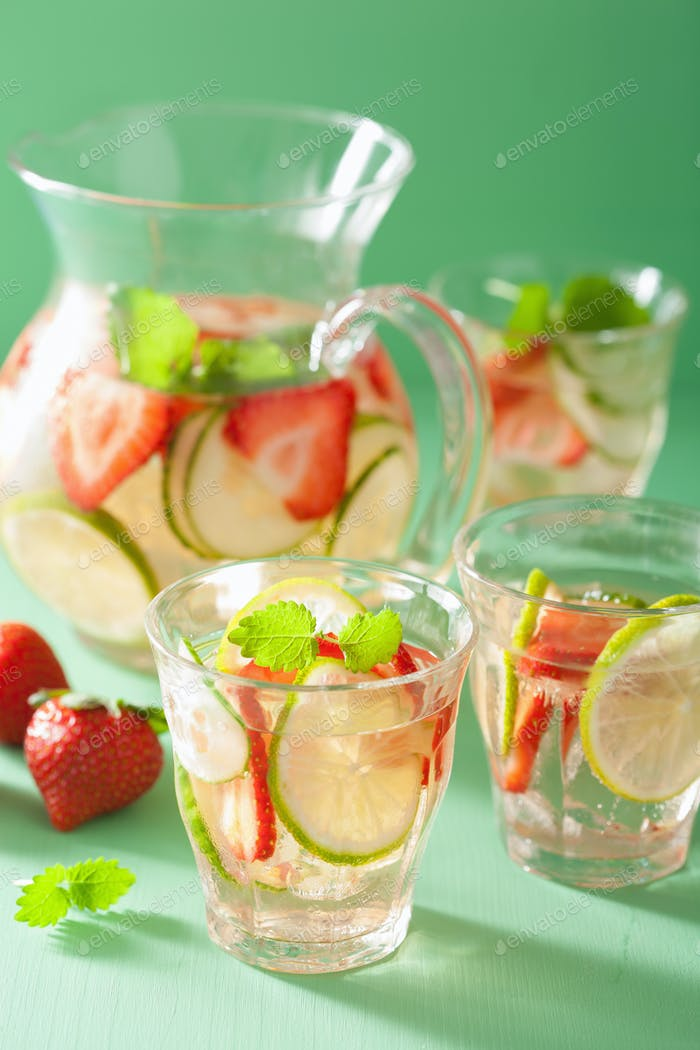 refreshing summer drink with strawberry cucumber lime in jar and
