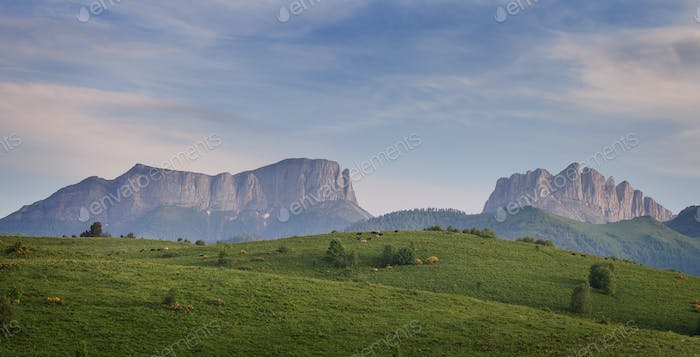 Green field on a background mountains (Eastern and Western Aches