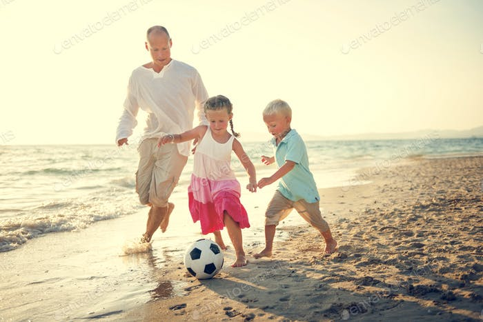 Football Beach Playing Leisure Activity Fun Concept