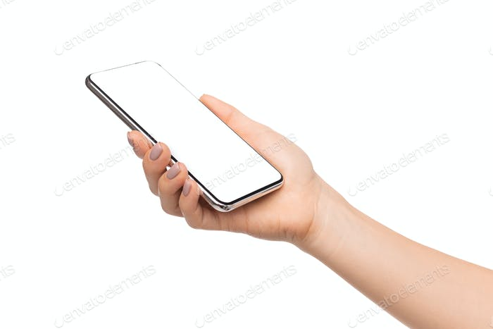 Smartphone with blank screen in female hands on white background