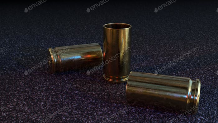 Empty Pistol Casings on Asphalt