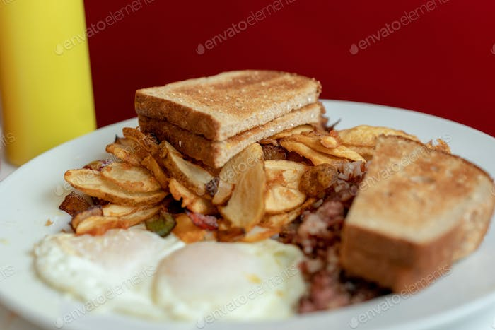 Close up of sandwich and chips and sunny side egg