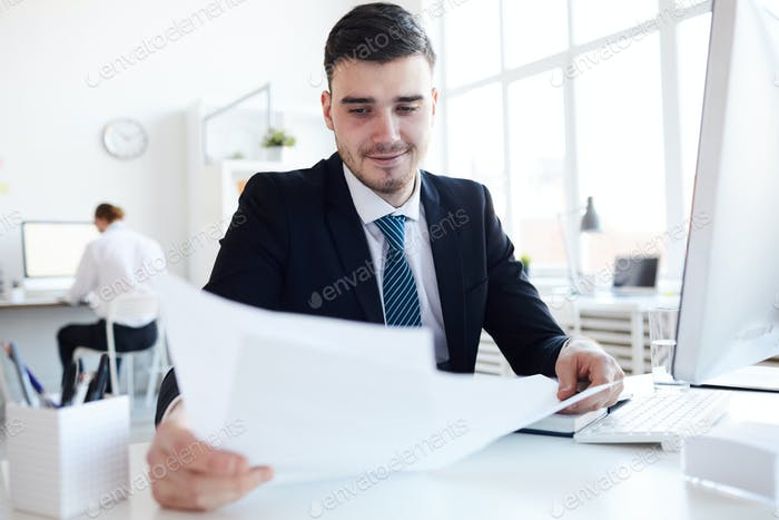 Young banker at work