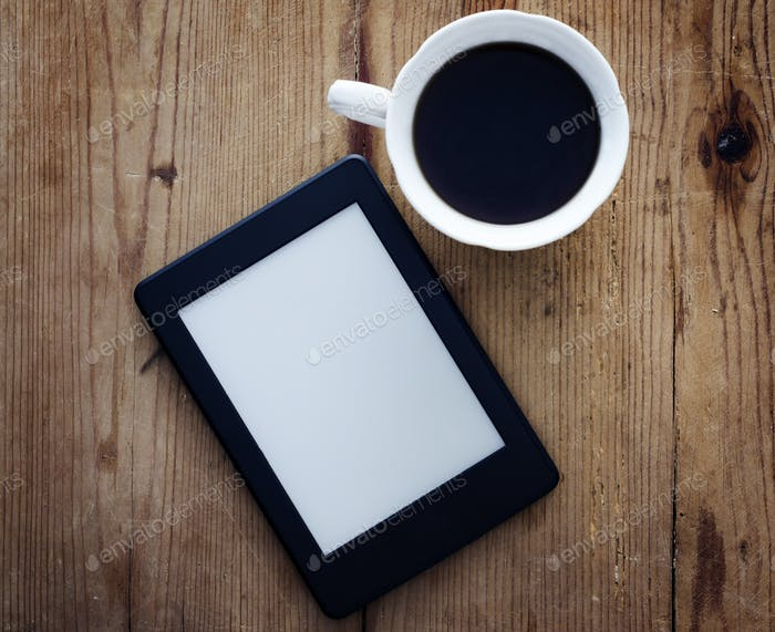 E-book reader and coffee cup